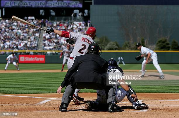 Eric Byrnes of the Arizona Diamondbacks gets a first inning base hit off of starting pitcher Mark Redman of the Colorado Rockies on opening day at...