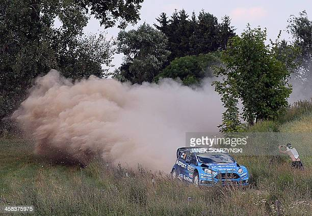 Eric Camilli and codriver Benjamin Veillas of France drive their Ford Fiesta RS WRC during the special stage at the Rally Poland in Stanczyki...