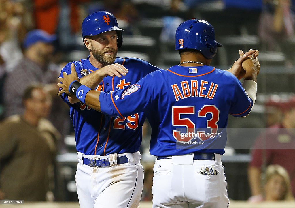 Eric Campbell #29 and Bobby Abreu #53 of the New York Mets congratulate each other after scoring on a two run double by Travis d'Arnaud #15 in the eighth inning against the Texas Rangers in a game on July 4, 2014 at Citi Field in the Flushing neighborhood of the Queens borough of New York City.