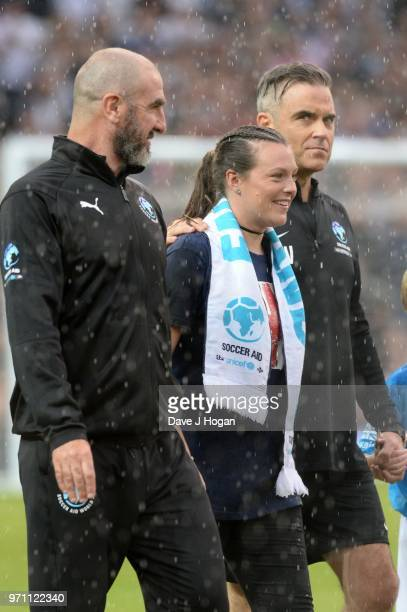 Eric Cantona and Robbie Williams walk out prior to kick off during Soccer Aid for Unicef 2018 at Old Trafford on June 10 2018 in Manchester England