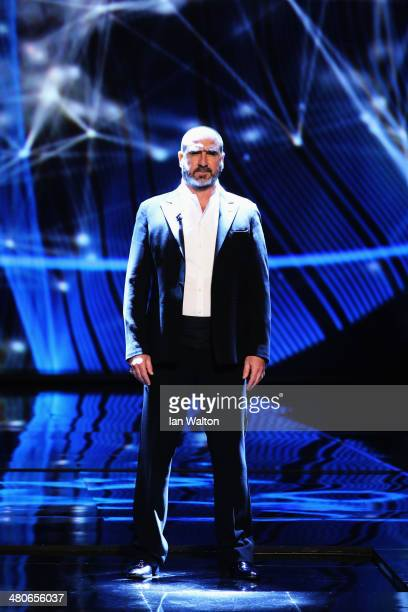 Eric Cantona arrives on stage during the 2014 Laureus World Sports Award show at the Istana Budaya Theatre on March 26 2014 in Kuala Lumpur Malaysia