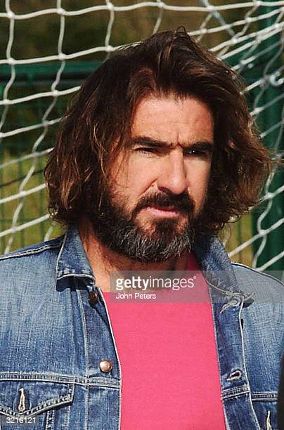 Eric Cantona attends the official opening of the Manchester United Soccer School at Disneyland Paris on April 4 2004 in Paris France