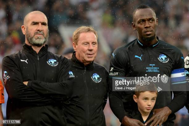 Eric Cantona Harry Redknapp and Usain Bolt lineup prior to kick off during Soccer Aid for Unicef 2018 at Old Trafford on June 10 2018 in Manchester...