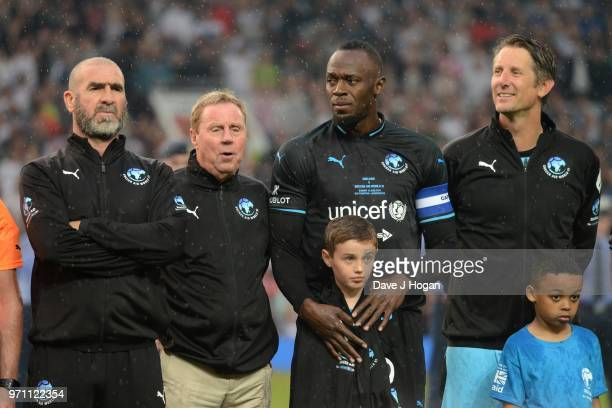 Eric Cantona Harry Redknapp Usain Bolt and Edwin Van Der Sar lineup prior to kick off during Soccer Aid for Unicef 2018 at Old Trafford on June 10...