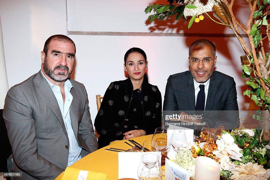 Eric Cantona, his wife Rachida Brakni and galerist Kamel Mennour attend the 'Diner des Amis du Musee d'Art Moderne' at Musee d'Art Moderne on October 21, 2014 in Paris, France.