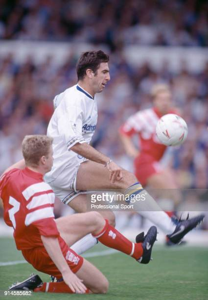 Eric Cantona of Leeds United is tackld by David Burrows of Liverpool during the FA Charity Shield at Wembley Stadium on August 8 1992 in London...