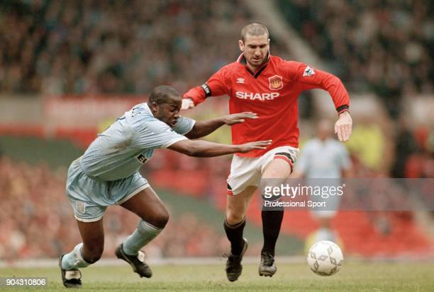 Eric Cantona of Manchester United and Paul Williams of Coventry City in action during an FA Carling Premiership match at Old Trafford on April 08...