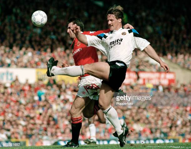 Eric Cantona of Manchester United and Shaun Teale of Aston Villa in action during an FA Premier League match at Old Trafford on March 14 1993 in...
