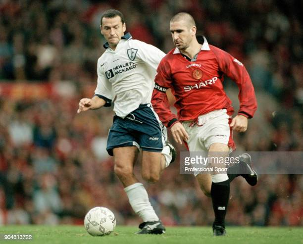 Eric Cantona of Manchester United battles with Colin Calderwood of Tottenham Hotspur during an FA Carling Premiership match at Old Trafford on March...