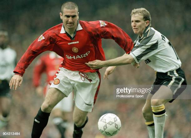 Eric Cantona of Manchester United battles with Paul Trollope of Derby County during an FA Carling Premiership match at Old Trafford on April 05 1997...