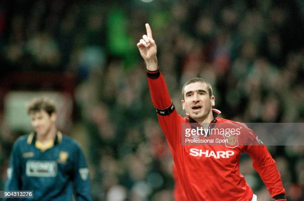 Eric Cantona of Manchester United celebrates after scoring during the FA Carling Premiership match between Wimbledon and Manchester United at...