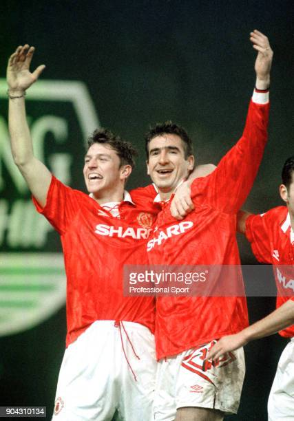 Eric Cantona of Manchester United is joined by teammate Lee Sharpe to celebrate scoring in the FA Carling Premiership match between Coventry City and...