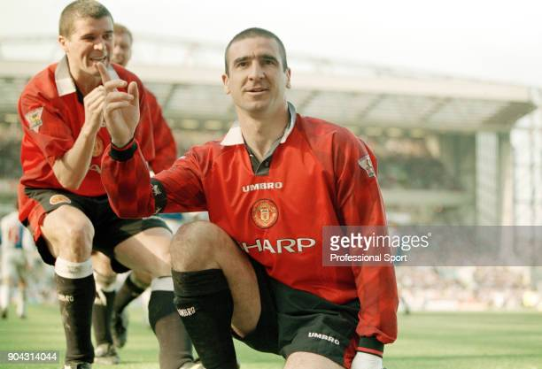 Eric Cantona of Manchester United is joined by teammate Roy Keane to celebrate scoring in the FA Carling Premiership match between Blackburn Rovers...