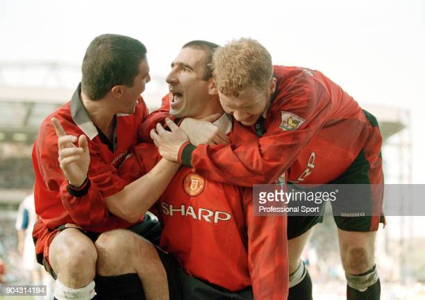 Eric Cantona of Manchester United is joined by teammates Roy Keane and Paul Scholes to celebrate scoring in the FA Carling Premiership match between...