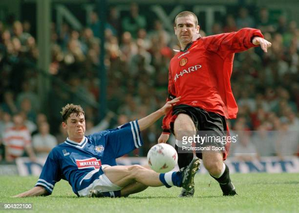 Eric Cantona of Manchester United is tackled by Stuart Campbell of Leicester City during an FA Carling Premiership match at Filbert Street on May 03...