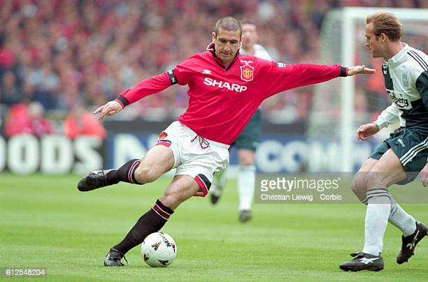 Eric Cantona of Manchester United kicks the soccer ball against Liverpool in the Premier League Cup final