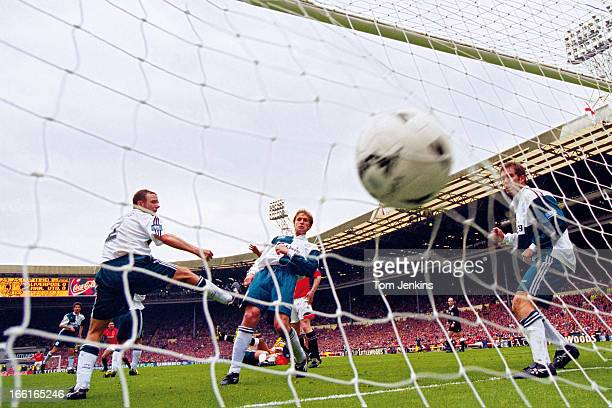 Eric Cantona of Manchester United scores the only goal of the game during the FA Cup Final Manchester United versus Liverpool at Wembley Stadium on...