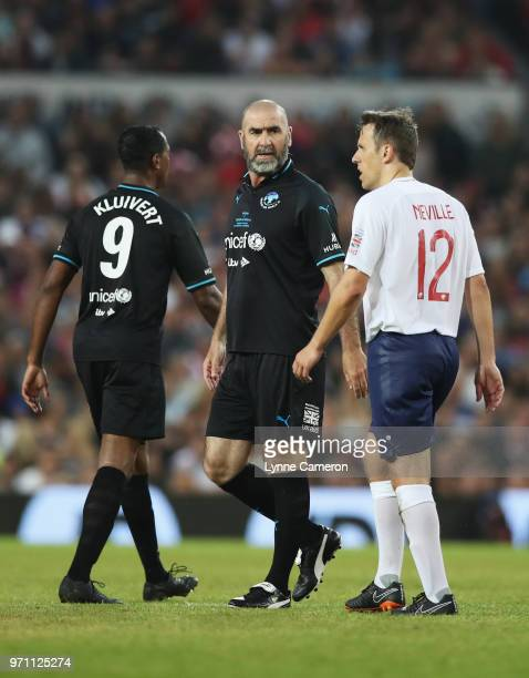 Eric Cantona of the Rest of the World and Phil Neville of England look on during the Soccer Aid for UNICEF 2018 match between Englannd and the Rest...