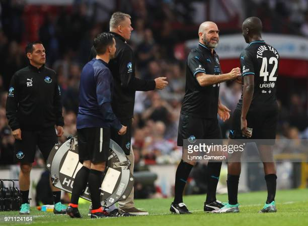 Eric Cantona of the Rest of the World replaces Yaya Toure of the Rest of the World as substitute during the Soccer Aid for UNICEF 2018 match between...