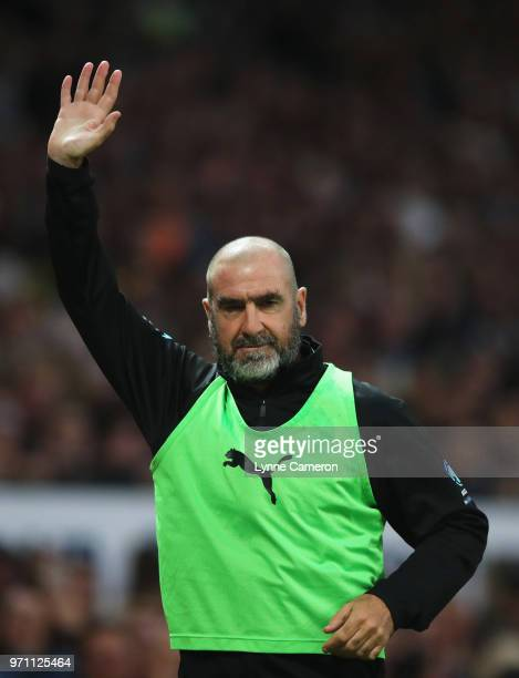 Eric Cantona of the Rest of the World salutes the crowd during the Soccer Aid for UNICEF 2018 match between Englannd and the Rest of the World at Old...