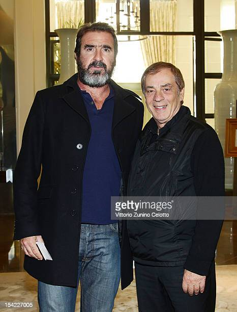 Eric Cantona poses with Antonio Caliendo as he arrives at MonteCarlo Bay prior to the Golden Foot Award 2012 ceremony on October 16 2012 in...