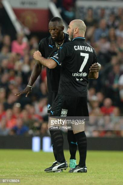 Eric Cantona speaks with Usain Bolt during Soccer Aid for Unicef 2018 at Old Trafford on June 10 2018 in Manchester England
