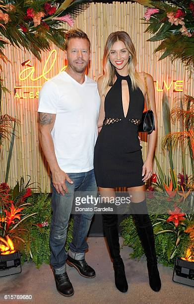 Eric Chambers and model Ludi Delfino attend Ale by Alessandra X REVOLVE at Revolve Social Club on October 19 2016 in Los Angeles California