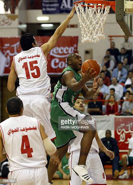 Eric Chatfild of the Lebanese alHikmeh club fights for the ball with Sharif alDiasti and Tarek Kheiry of the Egyptian alAhli club during their Dubai...
