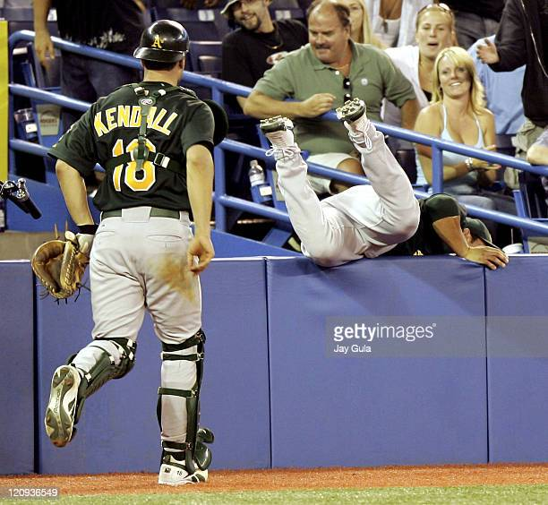 Eric Chavez nearly falls into the camera bay chasing a foul popup in Oakland's 42 loss to the Toronto Blue Jays at Rogers Centre in Toronto Canada on...