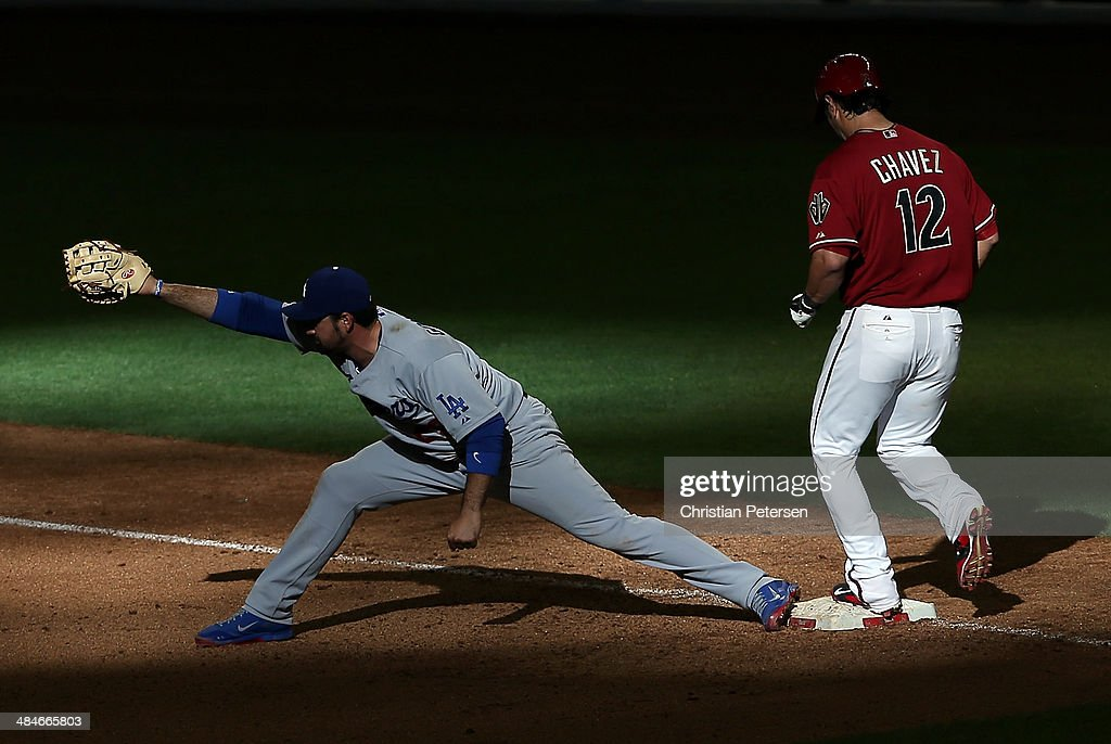 Eric Chavez #12 of the Arizona Diamondbacks is forced out at first base by infielder Adrian Gonzalez #23 of the Los Angeles Dodgers during the ninth inning of the MLB game at Chase Field on April 13, 2014 in Phoenix, Arizona. The Dodgers defeated the Diamondbacks 8-6.