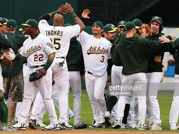 Eric Chavez of the Oakland Athletics celebrates with teammates after winning game three of the American League Division Series against the Minnesota...