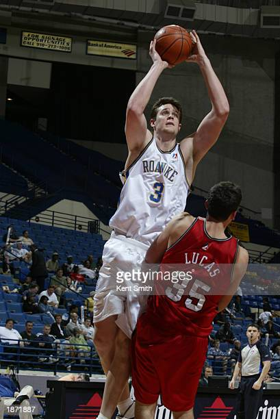 Eric Chenowith of the Roanoke Dazzle goes over Bryan Lucas of the Fayetteville Patriots during the NBDL Playoffs at the Crown Coliseum on March 25,...