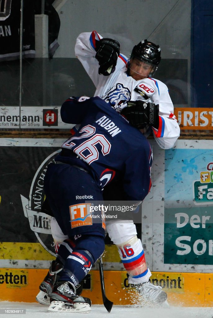 Eric Chouinard of Thomas Sabo Ice Tigers fights with Brent Aubin of EHC Red Bull Muenchen during the DEL match between EHC Red Bull Muenchen and Thomas Sabo Ice Tigers at Olympia Eishalle on March 1, 2013 in Munich, Germany.