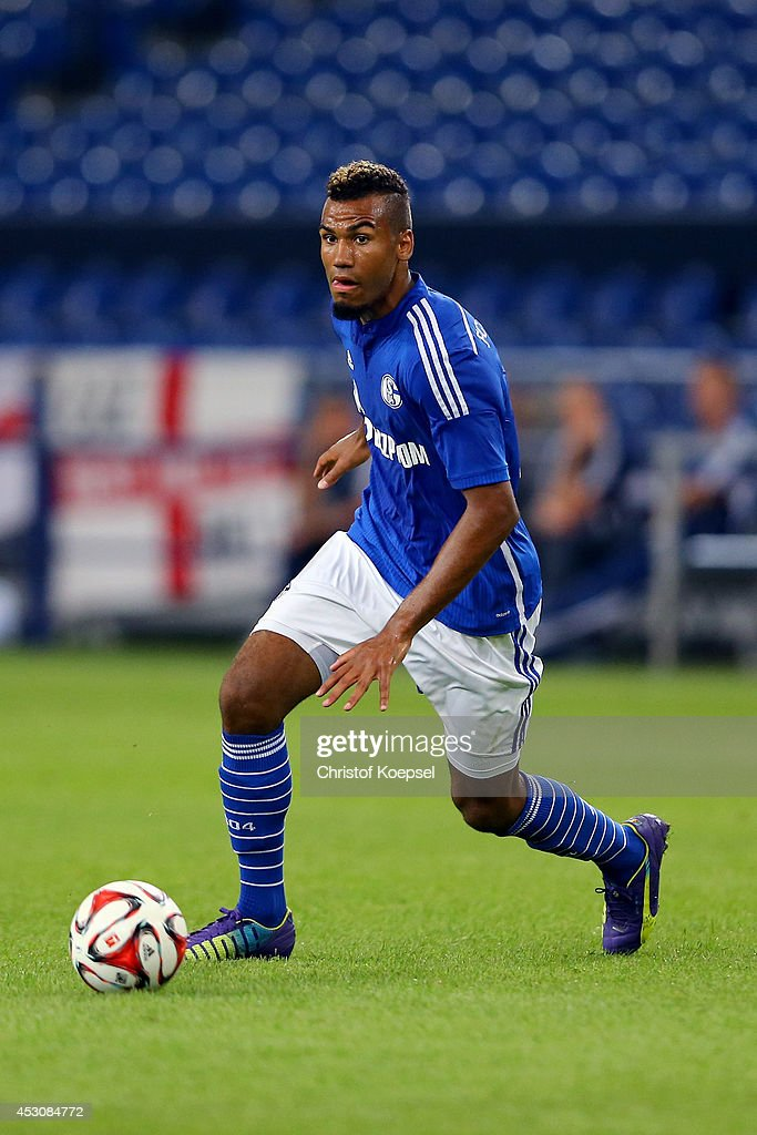Eric Choupo-Moting of Schalke runs with the ball during the match between FC Schalke 04 and West Ham United as part of the Schalke 04 Cup Day at Veltins-Arena on August 2, 2014 in Gelsenkirchen, Germany.