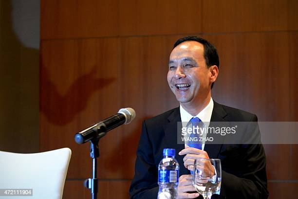 Eric Chu, chairman of Taiwan's ruling Kuomintang party laughs during a press conference at a hotel in Beijing on May 4, 2015. China's Communist Party...