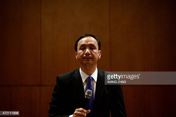 Eric Chu, chairman of Taiwan's ruling Kuomintang party prepares to answer a question during a press conference at a hotel in Beijing on May 4, 2015....