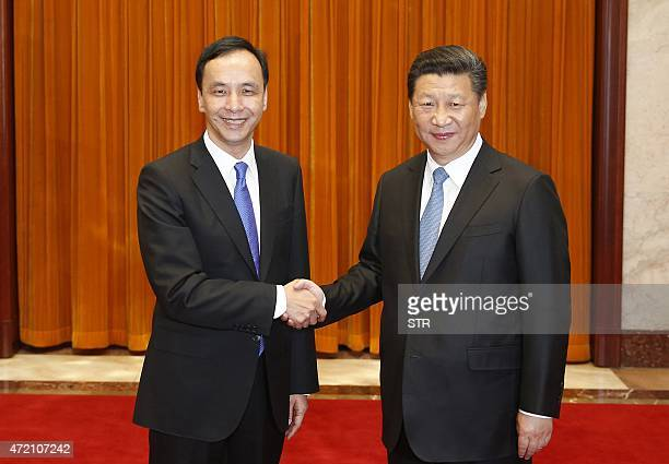 Eric Chu , chairman of Taiwan's ruling Kuomintang party, shakes hands with Chinese President Xi Jinping during a visit to the Great Hall of the...