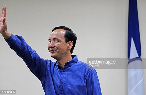 Eric Chu, chairman of Taiwan's ruling Kuomintang , waves during a press conference in Taipei on May 16, 2015. Chu said he will step down as the KMT...
