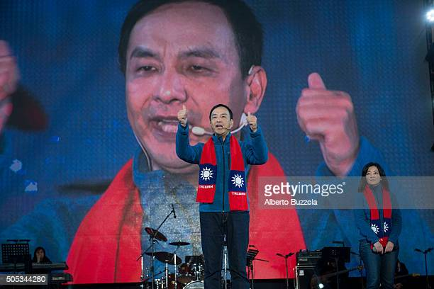 Eric Chu of the KMT, or Kuomintang, raises his thumbs during a speech in what was his last rally before election day. Eric Chu lost his bid by over 3...