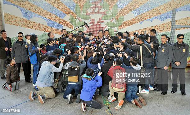 Eric Chu , presidential candidate from the ruling Kuomintang , speaks to the media after he voted at a polling station in New Taipei City on January...