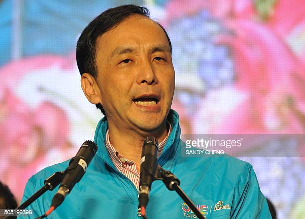Eric Chu, presidential candidate from the ruling Kuomintang , speaks to supporters as he concedes defeat in presidential polls outside the party...