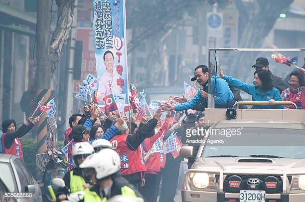 Eric Chu, the presidential candidate of the ruling Kuomintang , greets his supporters as he routes the streets of Taipei on January 15, 2016. Taiwan...