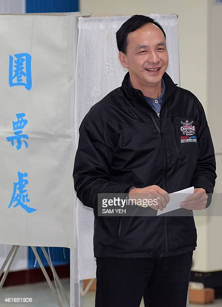 Eric Chu, vice chairman of the ruling Kuomintang , prepares to cast his vote in the party's election at a polling station in New Taipei City on...