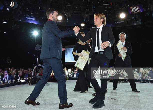 Eric Church and Keith Urban onstage at the 64th Annual BMI Country Awards at BMI on November 1 2016 in Nashville Tennessee