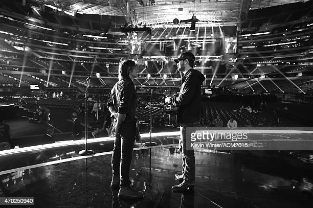 Eric Church and Keith Urban rehearse onstage for the 50th Academy of Country Music Awards at ATT Stadium on April 18 2015 in Arlington Texas