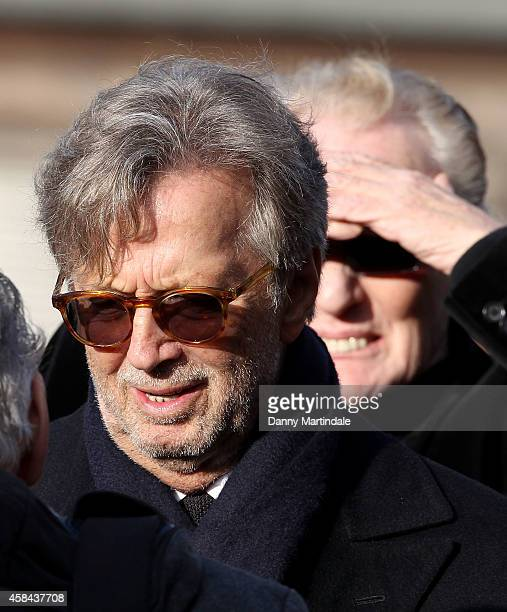 Eric Clapton and Ginger Baker attends the funeral of Jack Bruce at Golders Green Crematorium on November 5 2014 in London England