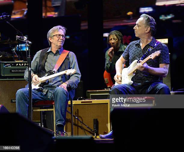 Eric Clapton and Jimmie Vaughan perform on stage during the 2013 Crossroads Guitar Festival at Madison Square Garden on April 12 2013 in New York City