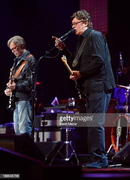 Eric Clapton and Robbie Robertson performs on stage during the 2013 Crossroads Guitar Festival at Madison Square Garden on April 13 2013 in New York...