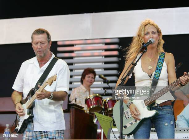 Eric Clapton and Sheryl Crow perform at Eric Clapton's Crossroads Guitar Festival 2007 held at Toyota Park on July 28 2007 in Bridgeview Illinois
