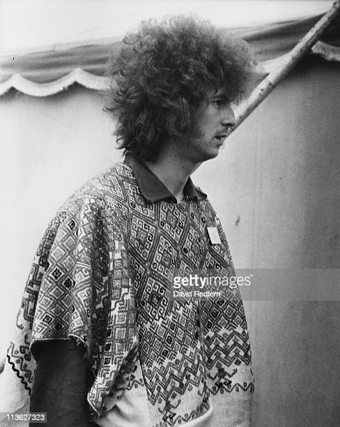 Eric Clapton British guitarist wearing a poncho at the National Jazz and Blues Festival at the Royal Windsor Racecourse in Windsor Berkshire England...